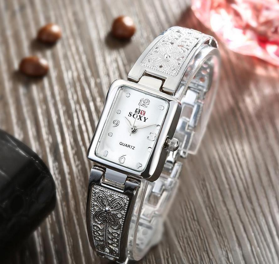 LADY'S THIN LUXURY WHITE FACED WATCH