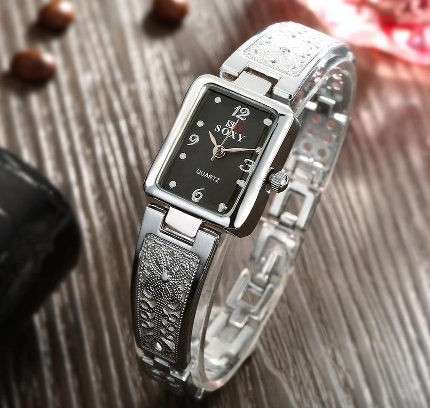 LADY;S THIN LUXURY BLACK FACED WATCH